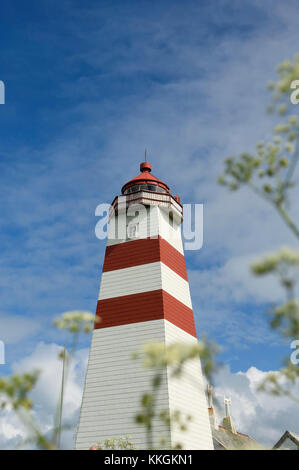 Alnes Lighthouse on the island of Godøy, west coast of Norway. - Stock Photo
