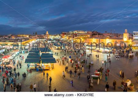 Morocco, Marrakech-Safi (Marrakesh-Tensift-El Haouz) region, Marrakesh. Jamaa El-Fna square at dusk. - Stock Photo