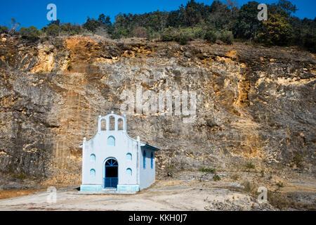 SAN CRISTOBAL DE LAS CASAS, MEXICO - JANUARY 20, 2015: SMALL LIGHT BLUE CHURCH AT FOOT OF MOUNTAIN, - Stock Photo