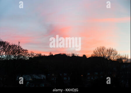 Brighton, East Sussex. 1st December 2017. UK Weather. Pink skies over Bevendean rooftops after a bright and chilly - Stock Photo