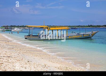 Outrigger tourist boat on the island Gili Trawangan, largest of Lombok's Gili Islands, Indonesia - Stock Photo