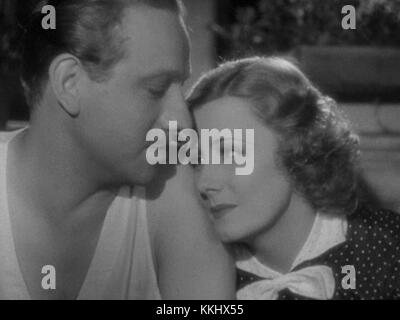 Irene Dunne and Melvyn Douglas in Theodora Goes Wild - Stock Photo