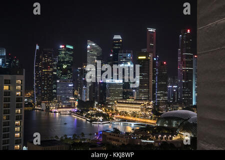 Dusk shot of  the Marina Bay area in Singapore, taken from the Pan Pacific Hotel showing the Singapore skyline at - Stock Photo