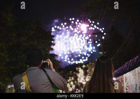 Couple enjoying fireworks. New years, holiday celebrating - Stock Photo