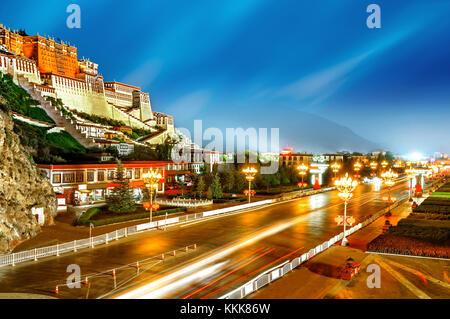 Potala Palace in Lhasa, the former residence of the Dalai Lama, Tibet, China, Asia, night horizontal city view. - Stock Photo