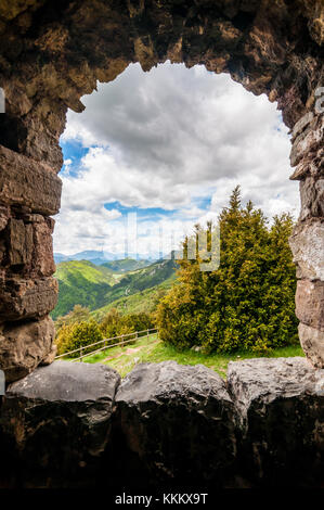 view from the window to the mountains, Sant Pere de Montgrony church, Gombren, Ripolles, Catalonia - Stock Photo
