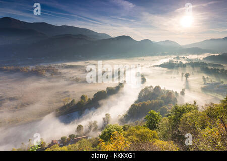 Mist over Adda river seen from Airuno at the Santuario Madonna della Rocchetta, Airuno, Parco dell'Adda Nord, Lecco - Stock Photo