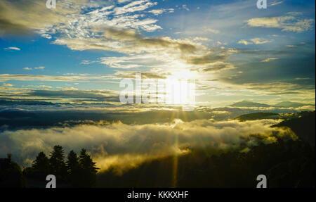 Mountain scenery with cloudscape at sunrise in Paro, Bhutan. - Stock Photo
