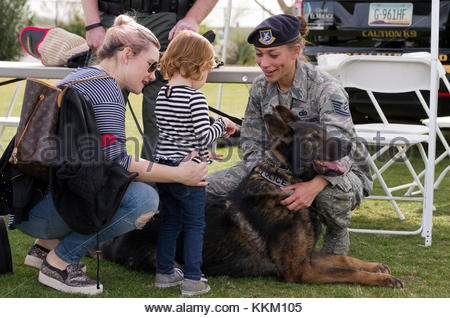 A U.S. Air Force Military Working Dog Handler shows off her police dog at a public safety event in El Mirage, Arizona. - Stock Photo