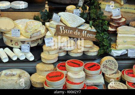 A selection of french Brie and other cheeses on a continental and french cheese stall at borough market in London. - Stock Photo