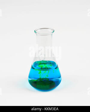 Flask with blue liquid and white background - Stock Photo
