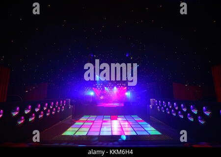 An empty dance floor with illuminated disco squares.  ready for a dance party and celebration.  Seventies kitsch - Stock Photo