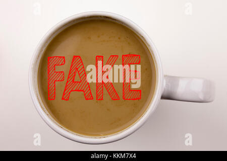 Word, writing Fake News text in coffee in cup. Business concept for Fake News on white background with space. Black - Stock Photo