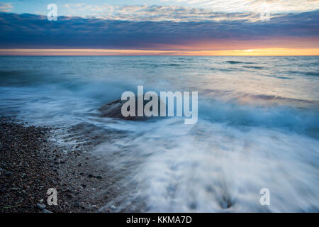 Sunset on the moving  Baltic Sea - Stock Photo