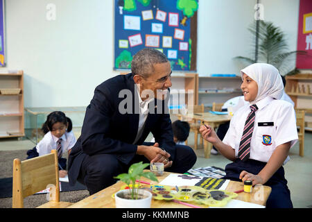 Nov. 21, 2015 'The President talks with a young refugee at a Dignity for Children Foundation classroom in Kuala - Stock Photo