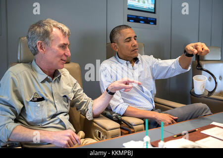 President Barack Obama talks with Bill Nye, the Science Guy, aboard Air Force One en route to Miami, Fla., April 22, 2015. (Official White House Photo by Pete Souza)  This official White House photograph is being made available only for publication by news organizations and/or for personal use printing by the subject(s) of the photograph. The photograph may not be manipulated in any way and may not be used in commercial or political materials, advertisements, emails, products, promotions that in any way suggests approval or endorsement of the President, the First Family, or the White House.