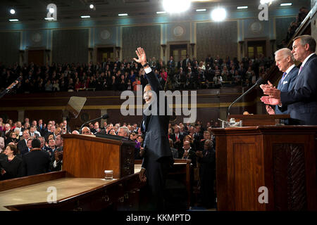 President Barack Obama acknowledges applause before he delivers the State of the Union address in the House Chamber - Stock Photo