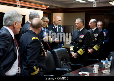President Barack Obama talks with the Joint Chiefs of Staff following a meeting in the Situation Room of the White - Stock Photo