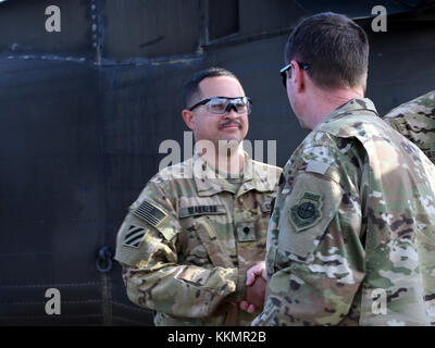 U.S. Army Soldiers with Task Force Marauder were presented with coins from U.S. Air Force Gen. Joseph Lengyel, Chief, - Stock Photo
