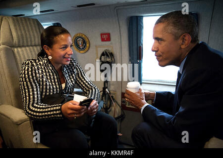 President Barack Obama talks with National Security Advisor Susan E. Rice aboard Marine One en route to Stonehenge - Stock Photo