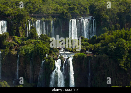 Tourists on walkway above Iguazu Falls, Argentina, seen from Brazil side, South America
