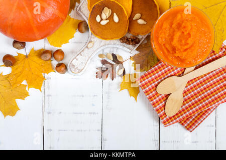 Golden tasty useful pumpkin pancakes, puree of a pumpkin on a white background. Autumn collection. Top view, free - Stock Photo