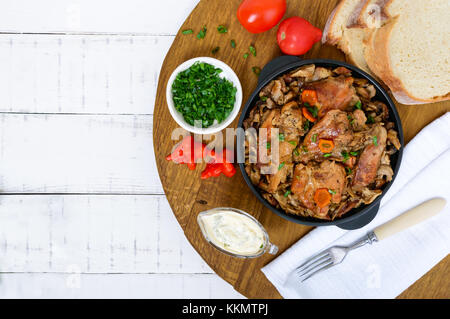 Tender rabbit meat with forest mushrooms. A dietary dish. Top view. - Stock Photo