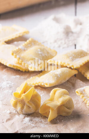 Close up of homemade pasta ravioli and perle on table with flour. See serires - Stock Photo