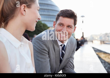 Businesspeople Walking To Work By River Thames In London - Stock Photo