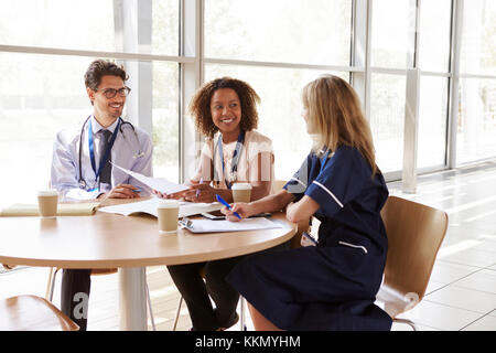 Senior healthcare workers in consultation in a meeting room - Stock Photo