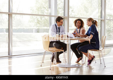 Three senior healthcare workers in a meeting - Stock Photo
