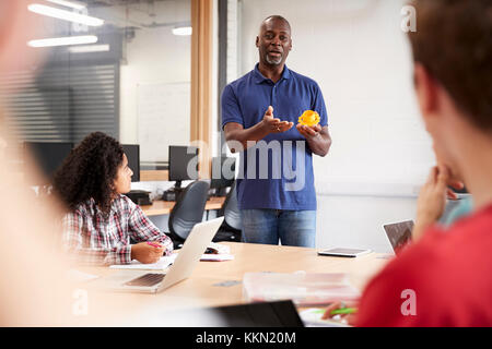 Teacher In Lesson For College Students Studying CAD/3D Design - Stock Photo