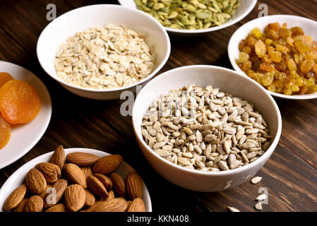 Healthy breakfast with nuts, seeds and dried fruits. Concept of natural organic food - Stock Photo