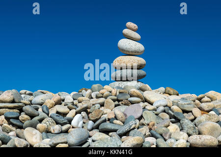 Rock cairn on Stonewall Beach, Chilmark, Matha's Vineyard, Massachusetts, USA. - Stock Photo