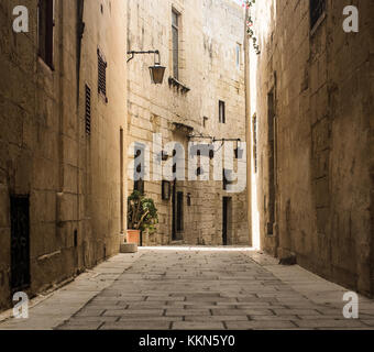 A narrow typical and historic road in Mdina, Malta - Stock Photo