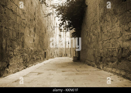 Old narrow Street in Mdina Malta in sepia. - Stock Photo