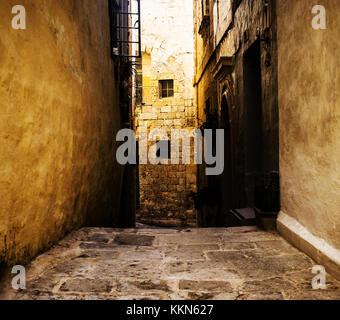 A narrow typical and historic road in Mdina, Malta - Stock Photo