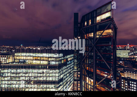 Elevated aerial view of luxury modern apartment buildings on London cityscape skyline at night