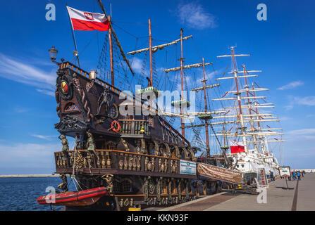 Dragon galleon tourist ship in Port of Gdynia city, Pomeranian Voivodeship of Poland. STS Dar Mlodziezy (Gift of - Stock Photo