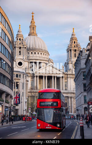 Red London double-decker bus in front of St Paul's Cathedral in the City of London financial district - Stock Photo