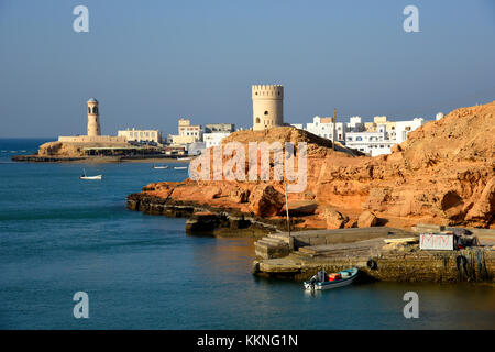Oman Sur A view of Ayjah with watch towers and the old light house in the background - Stock Photo