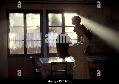 Mother with baby in the kitchen - Stock Photo