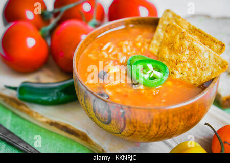 Hot And Spicy Fresh Made Mexican Chili Soup On Rustic Background - Stock Photo