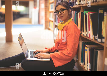 Portrait of confident girl using laptop - Stock Photo