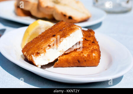 Portion of traditional Greek fried feta cheese - Stock Photo