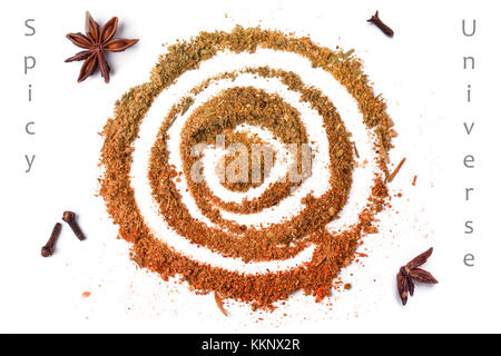 Top view on spiral of spices over white with sample text - Stock Photo
