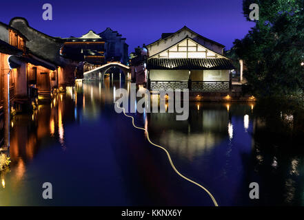 Night view of the ancient building by the water in Wuzhen. Wuzhen - historic ancient water town, part of Tongxiang, - Stock Photo