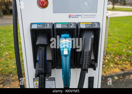 Public plug-in charging station for electric cars - Stock Photo
