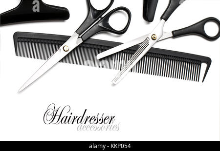Scissors and Comb for hair isolated on white - Stock Photo