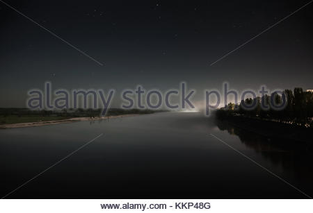 night over the river, the stars in the sky, the fog over the river, the view from the top, surface of the water, - Stock Photo
